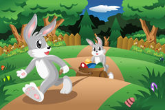 Rabbits pulling  an Easter egg cart Royalty Free Stock Images