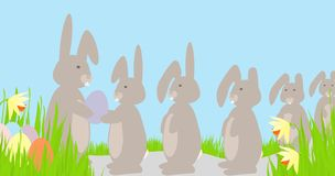 Rabbits Queue for Easter Eggs Stock Photos