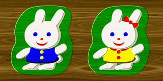 Rabbits relief painting on generated wood background Stock Photo