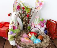 Easter eggs in basket and two Bunny Tilda Stock Image