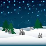 Rabbits in the snow, Christmas trees Stock Photo