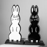Rabbits white and black wooden. Black and white rabbits made of wood from a magic trick but also conceptual. Black and white with a grey area in the background Royalty Free Stock Photos