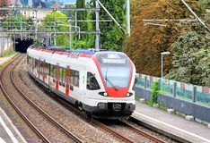 RABDe 500. MONTREUX, SWITZERLAND - AUGUST 6, 2014: White and red swiss short distance passenger train SBB-CFF-FFS RABDe 500 at the railway Stock Images