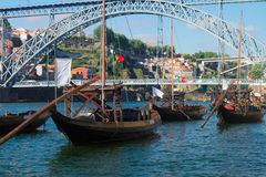 Rabelo boats and bridge of Dom Luis , Portugal Stock Images