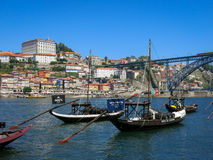 Rabelo boats and Ponte Luis I in Porto Stock Photos