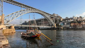 Rabelo Boats in the Ribeira District, with the Dom Luis I Bridge. Porto, Portugal stock video