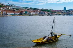 Rabelo boats, traditional Port wine transport on Douro river, with authentic Ribeira District view, Porto, Portugal. Royalty Free Stock Images