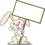 Rabiit holding sign. Cartoon of funny rabbit holding a sign Royalty Free Stock Photos