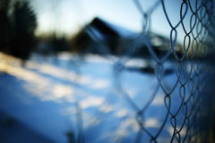 Rabitz winter background. Metal fence at winter background Stock Photo