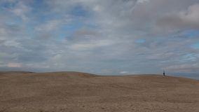 Rabjerg Mile is a migrating coastal dune between Skagen and Frederikshavn, Denmark. It is the largest moving dune in Northern Europe with an area of around 2 stock footage