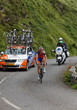 Rabobank team. Beost,France,July 15th 2011: Image of the cyclist Maarten Tjalingii (Rabobank) and the car of his team in the background while climbing the last Royalty Free Stock Photo