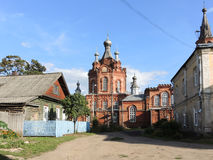 Rabochiy Gorodok street, Ostashkov. Russia. Ostashkov, Russian Federation - August 18, 2014: Rabochiy Gorodok means small town of workers. Church and hauses at royalty free stock images
