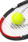 Racchetta di tennis con una sfera Fotografie Stock