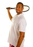 Racchetta di Tennsi dell'uomo di colore dietro il verticale capo Fotografia Stock