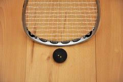 Racchetta e sfera di zucca Fotografie Stock