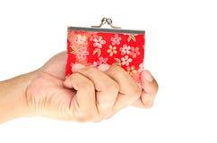 Raccoglitore della holding della mano Fotografie Stock