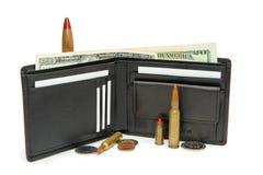 Raccoglitore, soldi e cartucce isolati Fotografia Stock Libera da Diritti
