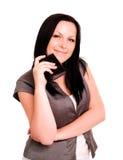 Raccoglitore sorridente della holding della donna sopra bianco Fotografie Stock Libere da Diritti