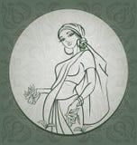 Raccoglitrice del tè con fondo regionale L'India Fotografia Stock