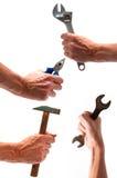 Raccolga di quattro mani con varia strumentazione Fotografia Stock Libera da Diritti