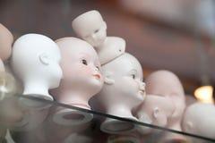 Raccolta calva delle bambole Immagine Stock