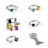 Raccolta degli anelli di diamante di lusso, su bianco Immagine Stock