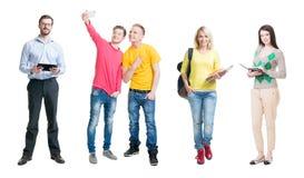 Raccolta degli studenti con il loro conferenziere su fondo isolato Fotografia Stock