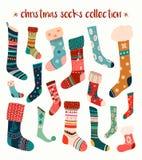 Raccolta dei calzini di Natale con gli elementi variopinti disegnati a mano Fotografia Stock