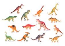 Raccolta dei dinosauri del giocattolo della plastica o del silicone Colpo dello studio e Immagine Stock