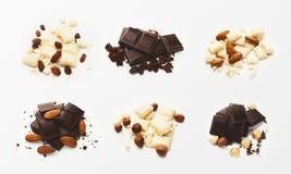 Raccolta dei generi differenti di cioccolato su fondo bianco immagini stock libere da diritti