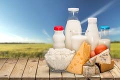 Raccolta dei prodotti lattier-caseario su luce verde Fotografia Stock