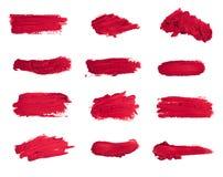 Raccolta dei rossetti macchiati isolati su bianco fotografie stock libere da diritti