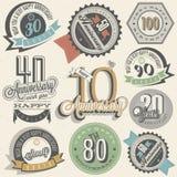 Raccolta del segno di anniversario e progettazione di carte nel retro stile Immagini Stock