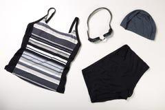 Raccolta del vestito, dei cappucci e dei vetri di nuoto Fotografie Stock
