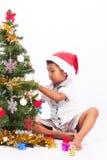 Raccolta dell'albero di Natale del gioco del ragazzo Immagine Stock Libera da Diritti