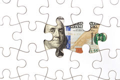 Raccolta della banconota del dollaro con il puzzle Fotografia Stock Libera da Diritti