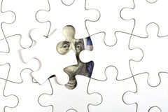 Raccolta della banconota del dollaro con il puzzle Fotografia Stock