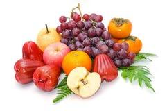Raccolta della frutta fresca su bianco Immagine Stock
