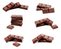 Raccolta della pila scura delle barre del cioccolato al latte delle foto isolata Fotografie Stock