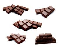 Raccolta della pila scura delle barre del cioccolato al latte delle foto isolata sopra Fotografia Stock Libera da Diritti