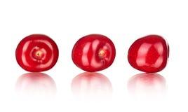 Raccolta delle ciliege con la riflessione Immagine Stock