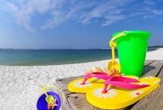 Raccolta delle coperture sulla spiaggia Immagine Stock
