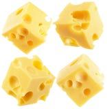 Raccolta delle fette del cubo del formaggio isolate su un fondo bianco Fotografie Stock