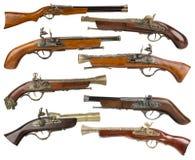 Raccolta delle pistole d'annata isolate sui precedenti bianchi Immagini Stock Libere da Diritti