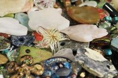 raccolta di plastica differente delle gemme come fondo piacevole Immagini Stock