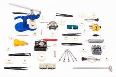 Raccolta di vari strumenti per la riparazione dell'orologio Fotografia Stock Libera da Diritti