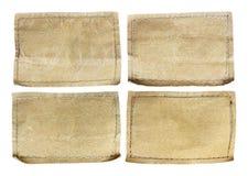 Raccolta di varie etichette dei jeans su bianco Fotografia Stock Libera da Diritti