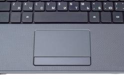 Raccolta elettronica - tastiera moderna del computer portatile con le lettere della t Immagine Stock