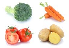 Raccolta fresca delle patate delle carote dei pomodori delle verdure isolata Fotografie Stock