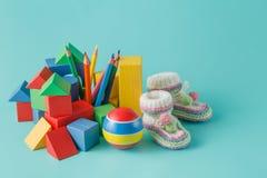 Raccolta variopinta dei giocattoli con su acquamarina Fotografia Stock Libera da Diritti